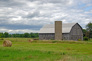 old barn with hay bales