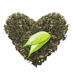 Fototapete - Green tea heart shape with leaf isolated on white background