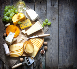 Various types of cheese with empty space background concept