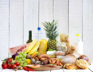 Variety of grocery products fruits meat cheese and bread