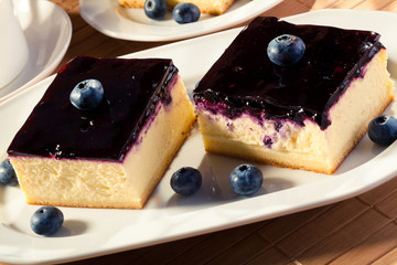 Cheesecake with blueberries and a cap of coffee
