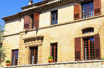 rural sandstone house with shutter windows in  Saint-Paul de Ven