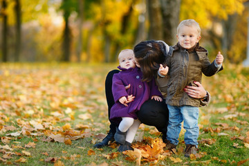 Happy family on beautiful autumn day
