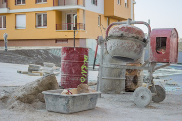 Cement mixer with barrel and plastic cement mixing trough