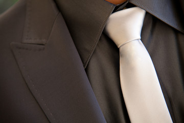 Groom with tie