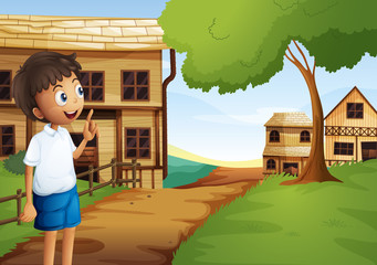 A boy at the pathway in the neighborhood