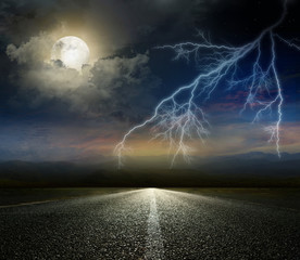 moon and lightning above the road
