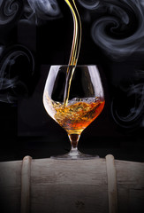Cognac glass shrouded in a smoke