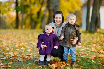 Happy family on beautiful autumn day