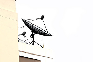 Satellite dish attached to the building.