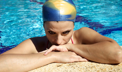 Female swimmer thinking about competition