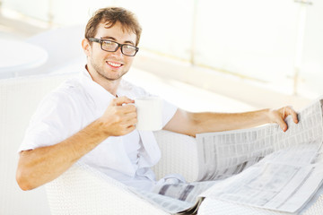 soft focus portrait of man reading a newspaper