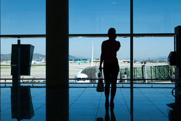 Silhouette of women in airport terminal