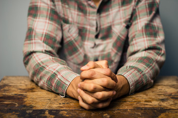 Praying man at table