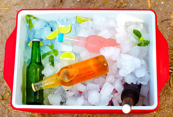 chilled colorful beverages in ice box. summer party
