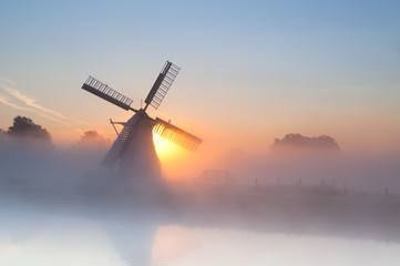 Wall Mural - Dutch windmill in dense fog