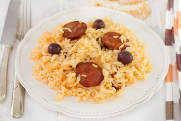rice with sausages on the white plate