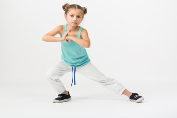 girl is standing in fighting stance with outstretched leg