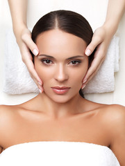 Wall Mural - Spa Woman. Close-up of a Young Woman Getting Spa Treatment. Face