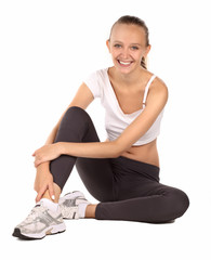 girl smiling and relaxing after aerobics - isolated on white
