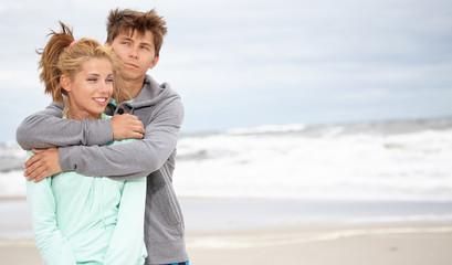Romantic young couple on autumn beach