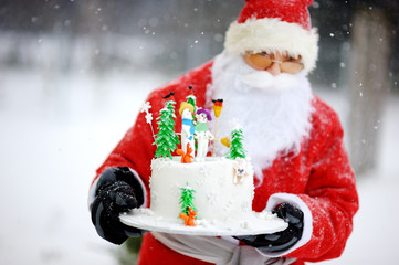 Traditional Santa Claus and a Christmas cake