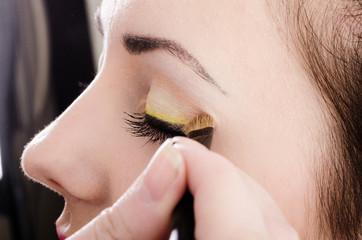 Beautician artist applying makeup