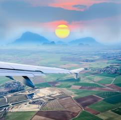aerial view through airplane porthole