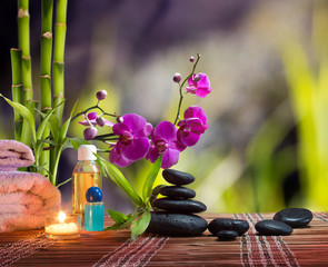 Wall Mural - composition bamboo-purple orchid-black stones in garden