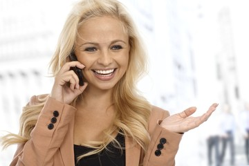 Businesswoman talking on cellphone on street
