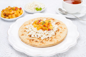 Flat bread with cottage cheese with honey, nuts, peaches