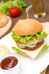 homemade chicken burger with vegetables, cheese, ketchup