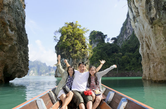 Happy Asian family enjoy a cruise on a holiday adventure by boat trip and beautiful nature landscape lake and mountain, Vacation travel Asia at Khao Sok National Park, Surat Thani, Guilin of Thailand