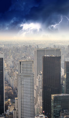 Fototapete - Dramatic sky over New York City - Aerial view