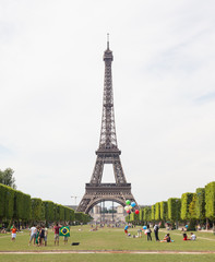 PARIS - JULY 27: Tourists at the Eiffel Tower on July 27, 2013,