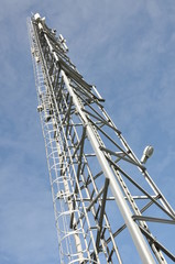 Telecommunication tower against a blue sky