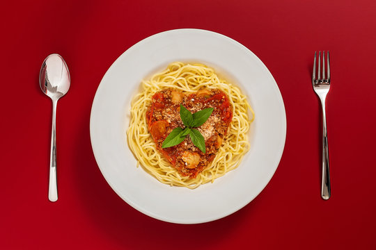 Pasta with tomato sauce and parmesan
