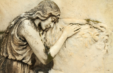 beautiful antique cemetery relief with sleeping angel