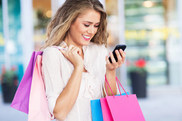 Shopping woman with mobile phone