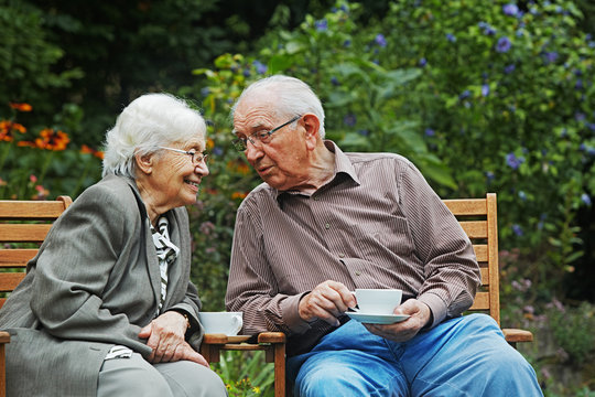 aged couple on the garden bench