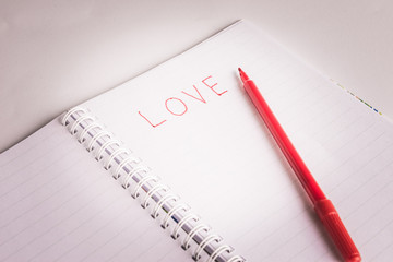 Red pen writing a love