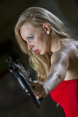 Spy in red dress and gun