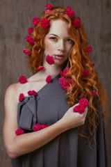 red-haired girl in flowers
