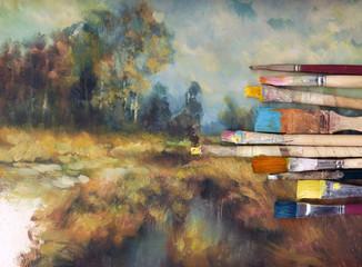 pinsel auf gemalter unfertiger landschaftstudie