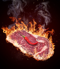 Cose-up of a steak with fire flames