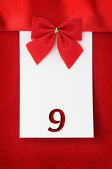 Number nine on red greeting card