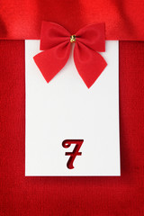 Number seven on red greeting card