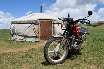 Mongolian Yurt and bike in the steppe
