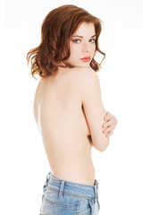 Beautiful fit sexy topless woman in blue jeans