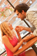 Cute young couple enjoying in cafe
